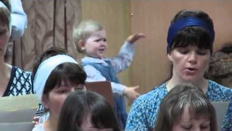 Video thumbnail for youtube video Toddler Conducts Choir Like a Boss, Wins the Internet