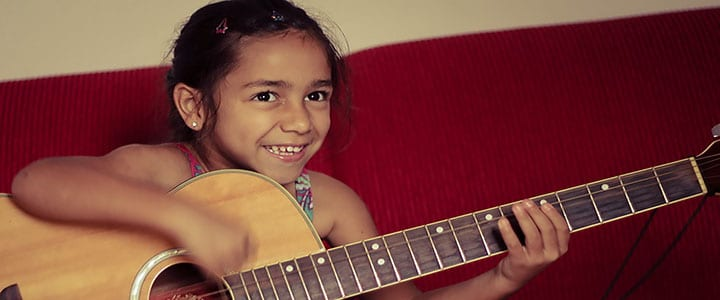 Kids' Guitar Lessons: How Often Should My Child Practice?