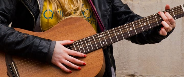 How to Strum a Guitar: A Beginner's First Lesson