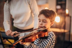 a child plays a half-size violin