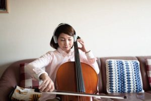 a young girl working to become a professional cello player