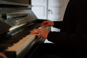 a pianist learning to change the key of a song