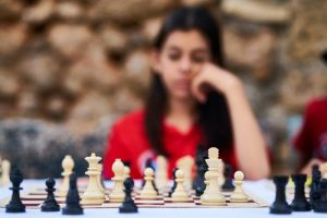 a chess player works on her endgame