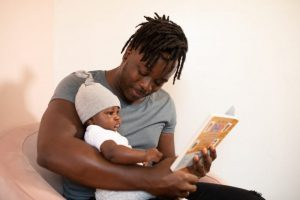 a father teaches his deaf child to read